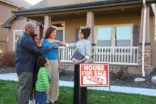 Realtor hands keys to new homeowners