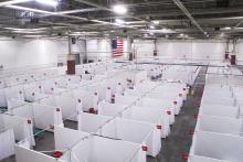 Aerial view of rows of cube-like temporary patient care spaces at the Alternate Care Facility at State Fair Park