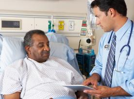 Doctor consulting with male patient in hospital