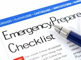 A title - emergency preparedness checklist with a pen
