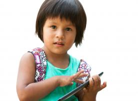 Girl using tablet device
