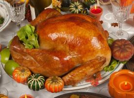 Thanksgiving turkey sitting on a decorated table