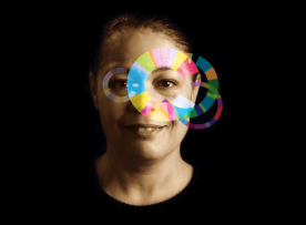 An adult with rainbow circles representing Trauma Informed Care