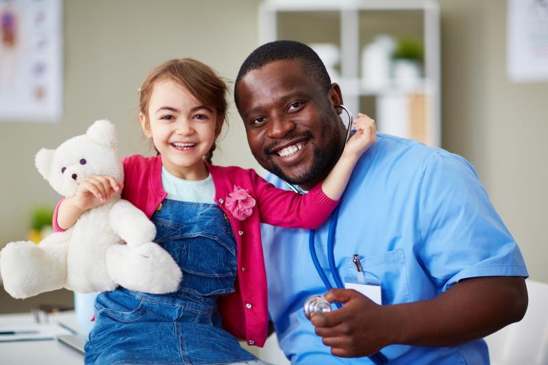 Doctor with child, all smiles