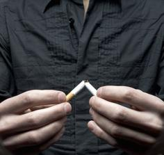 Image of a man who snapped a cigarette in half